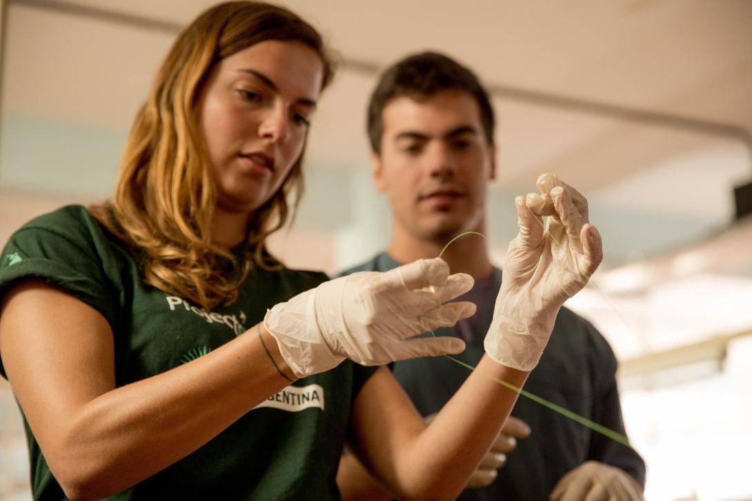 A medical intern in Argentina learns how to suture on a student placement abroad.